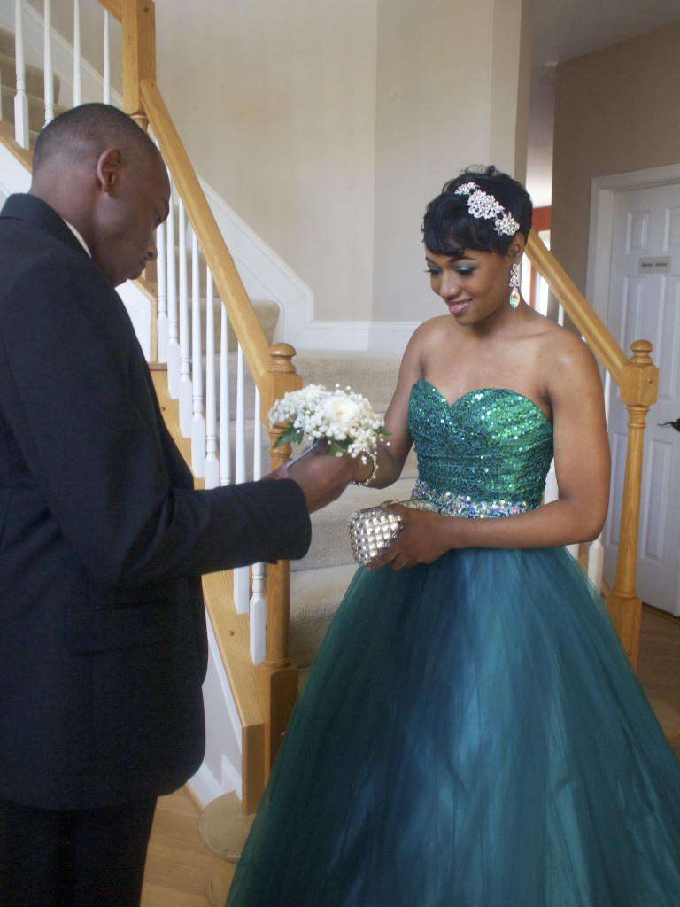Fahrelle receiving her corsage from her prom escort, Christian.